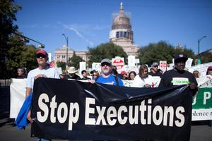 Death Row Exonerees leading a March to Abolish the Death Penalty in Austin